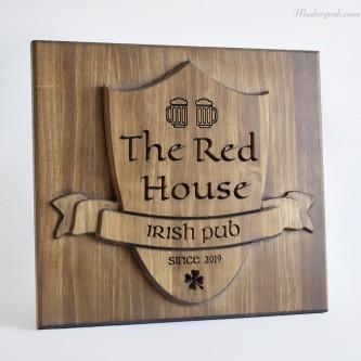 Logo de madera para pub.